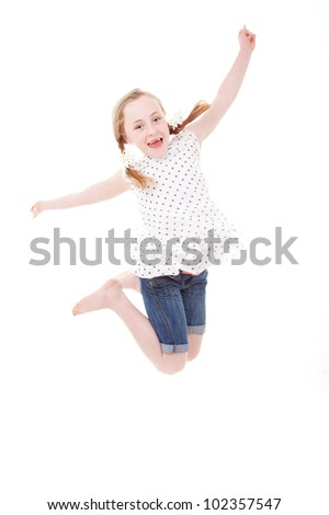 happy child kid or girl jumping - stock photo