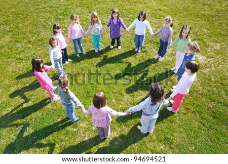 happy child kids group have fun and play at kindergarden outdoor preschool education concept with  teacher - stock photo