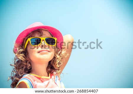 Happy child on summer vacation. Travel and adventure concept - stock photo