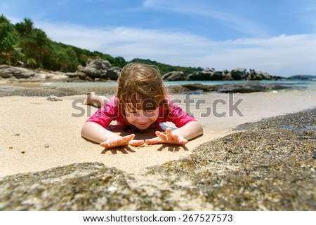 Happy child playing in sea.  - stock photo