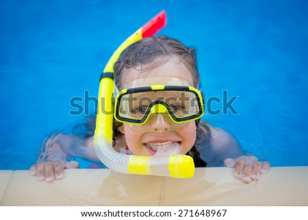 Happy child playing in swimming pool. Summer vacation concept - stock photo