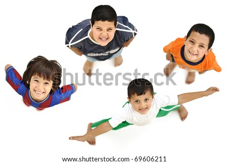 Happy child, positive fresh little smiling boy from above, different angle, isolated on white, full body - stock photo