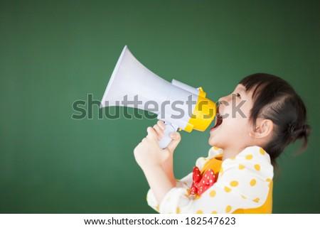happy child  using a megaphone with blackboard - stock photo