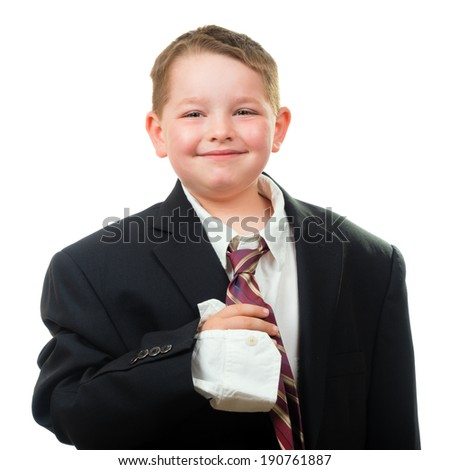 Happy child wearing suit that is too big for him - stock photo