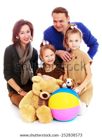 Happy childhood, the family concept.Cheerful young family with two young daughters. Isolated on white. - stock photo