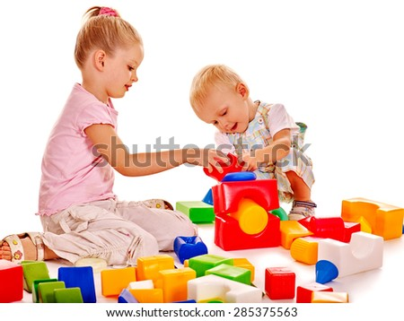 Happy children boy and girl playing building blocks on Isolated. - stock photo