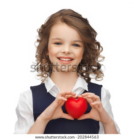 happy children, charity and health concept - picture of beautiful girl with small red heart - stock photo