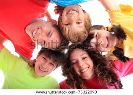Happy children in family circle smiling. - stock photo