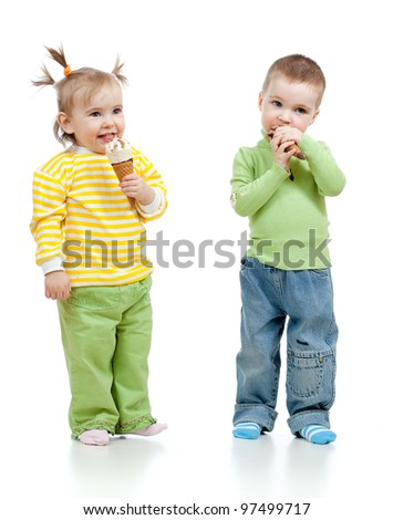 happy children little girl and boy eating ice cream in studio isolated - stock photo