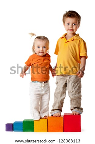 Happy children playing building blocks. Isolated. - stock photo