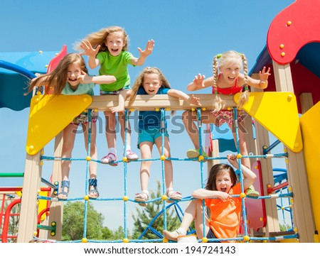 Happy children playing outdoors - stock photo