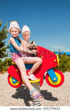 Happy children playing outside - stock photo