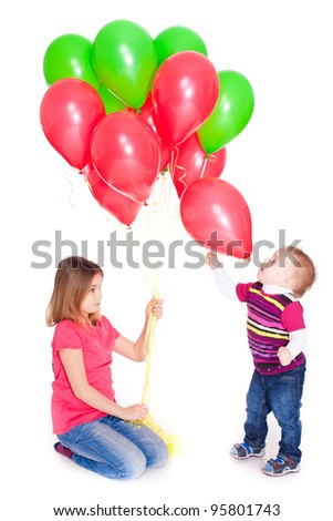 Happy children playing with baloons - stock photo