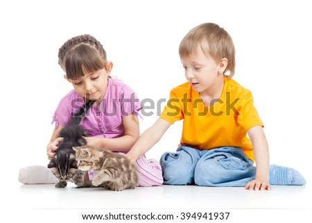 happy children playing with kitten - stock photo