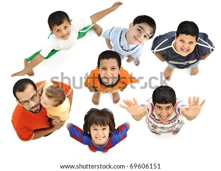 Happy children, positive fresh smiling boys from above, different angle, isolated on white, full body. Father with baby in arms with them. - stock photo