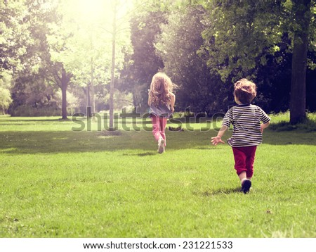 Happy children running at meadow, Vintage Color - stock photo