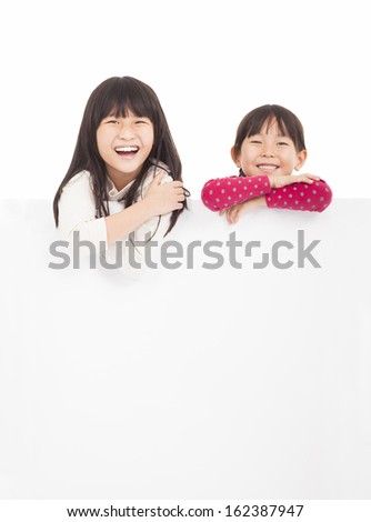 happy children showing blank board on a white background - stock photo