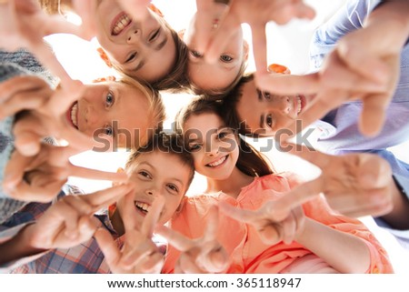 happy children showing peace hand sign - stock photo