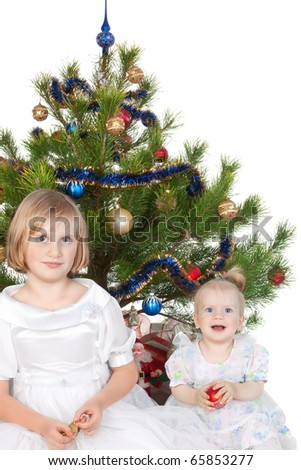 happy children under the Christmas tree on a white background - stock photo