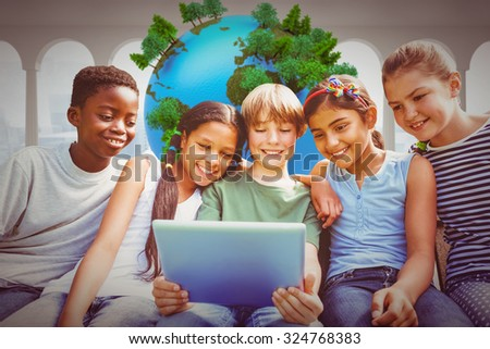 Happy children using digital tablet at park against earth floating in room - stock photo