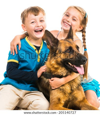happy children with a shepherd dog on a white background isolated close-up - stock photo