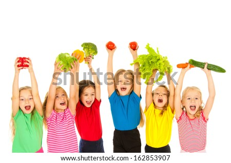 Happy children with vegetables - stock photo