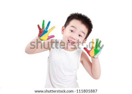 Happy Chinese boy, four years old, white background?Hands covered with color paint - stock photo