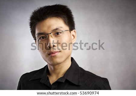 Happy Chinese man, series from several expression with vignetting and color hue in post processing - stock photo