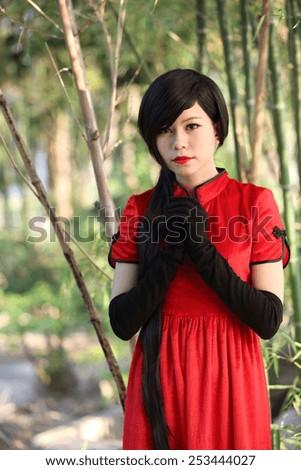 happy Chinese new year. beautiful young Asian woman dress traditional cheongsam - stock photo