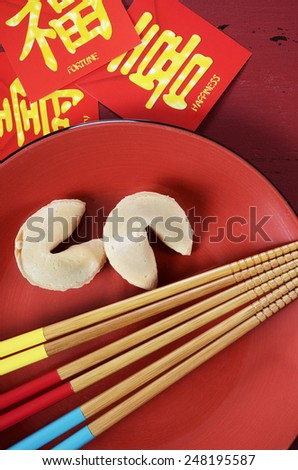 Happy Chinese New Year celebration party table place setting on red wood background. - stock photo