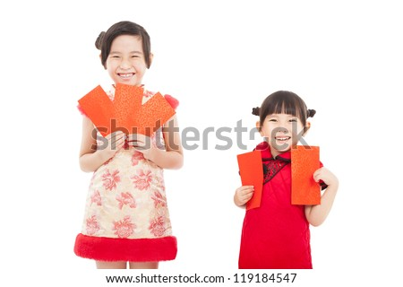 happy chinese new year. smiling asian little girls holding red envelope - stock photo