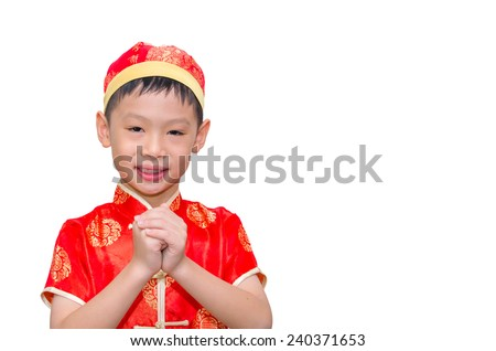 Happy Chinese new year.Young Asian boy with gesture of congratulation on white background - stock photo