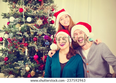 Happy Christmas Family portrait. Smiling Parents with teenage daughter at Home Celebrating New Year. Christmas Tree - stock photo