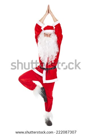 Happy Christmas Santa Claus doing yoga exercise tree-pose isolated on white background - stock photo