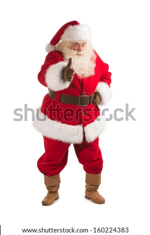 Happy Christmas Santa Claus showing thumb up. Isolated on white background. Full length - stock photo