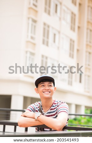Happy college student resting outdoors during the break - stock photo