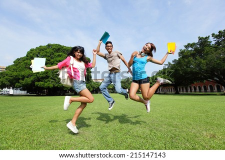 Happy College students jump and smile to you on campus lawn, asian - stock photo