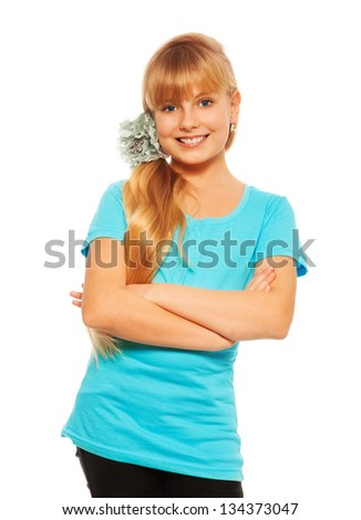 Happy confident blond girl standing isolated on white - stock photo