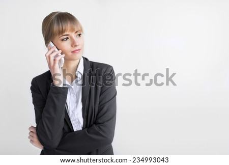 happy confident businesswoman talking on the mobile cell phone isolated on  - stock photo