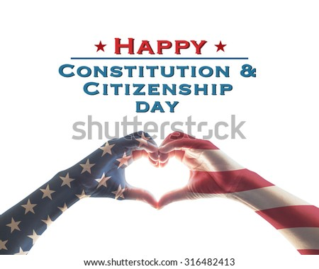 Happy constitution and citizenship day message with American flag red white blue star pattern on people hands in heart love shape on white background: USA patriot, memorial, independence concept   - stock photo
