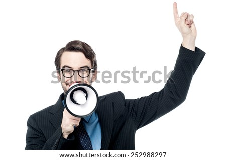 Happy corporate man making advertisement with loudhailer - stock photo