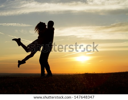 Happy Couple at Sunset - stock photo