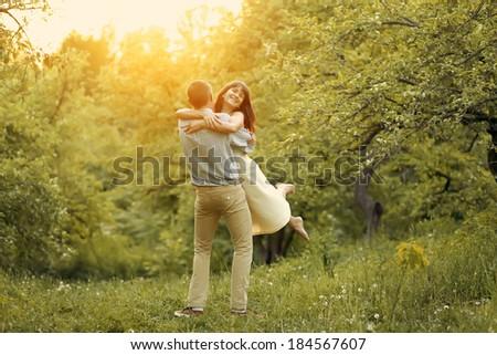 Happy Couple at Sunset - stock photo