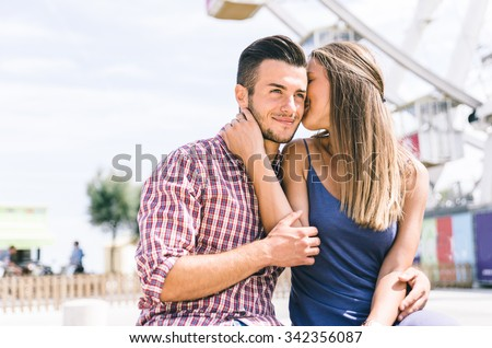 Happy couple at the amusement park. concept about relationship and love - stock photo