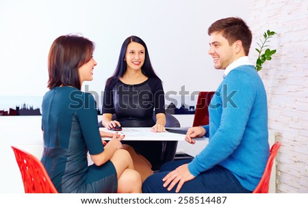 happy couple at the consultant, in the office - stock photo
