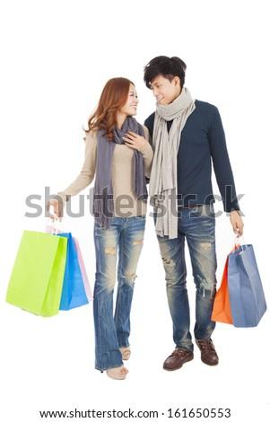 Happy couple doing shopping isolated on white - stock photo
