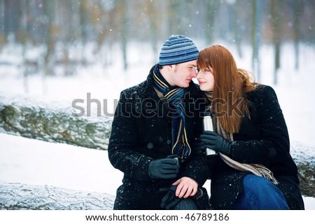 Happy couple drinking hot tea - stock photo