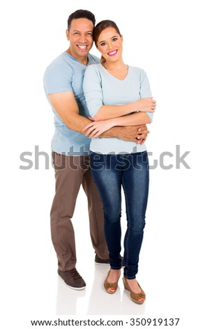 happy couple embracing on white background - stock photo