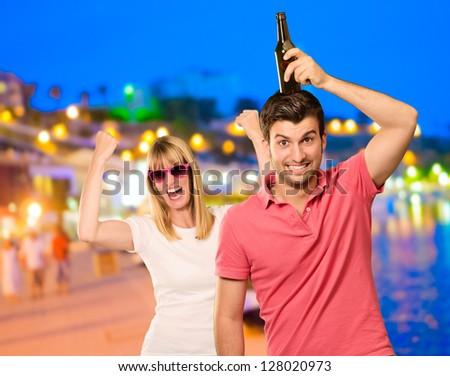 Happy Couple Enjoying The Vacations At Beach - stock photo