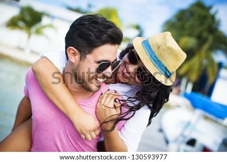 Happy couple enjoying vacations on the beach - stock photo